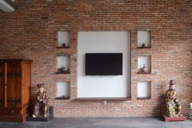 Old brick walls give the interior a classic, rustic appeal