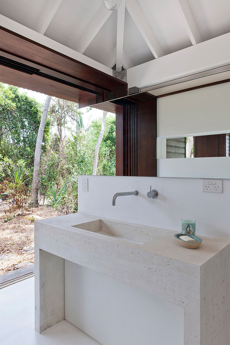 Small tropical style beach house opens up to the world outside for Small beach house interior design