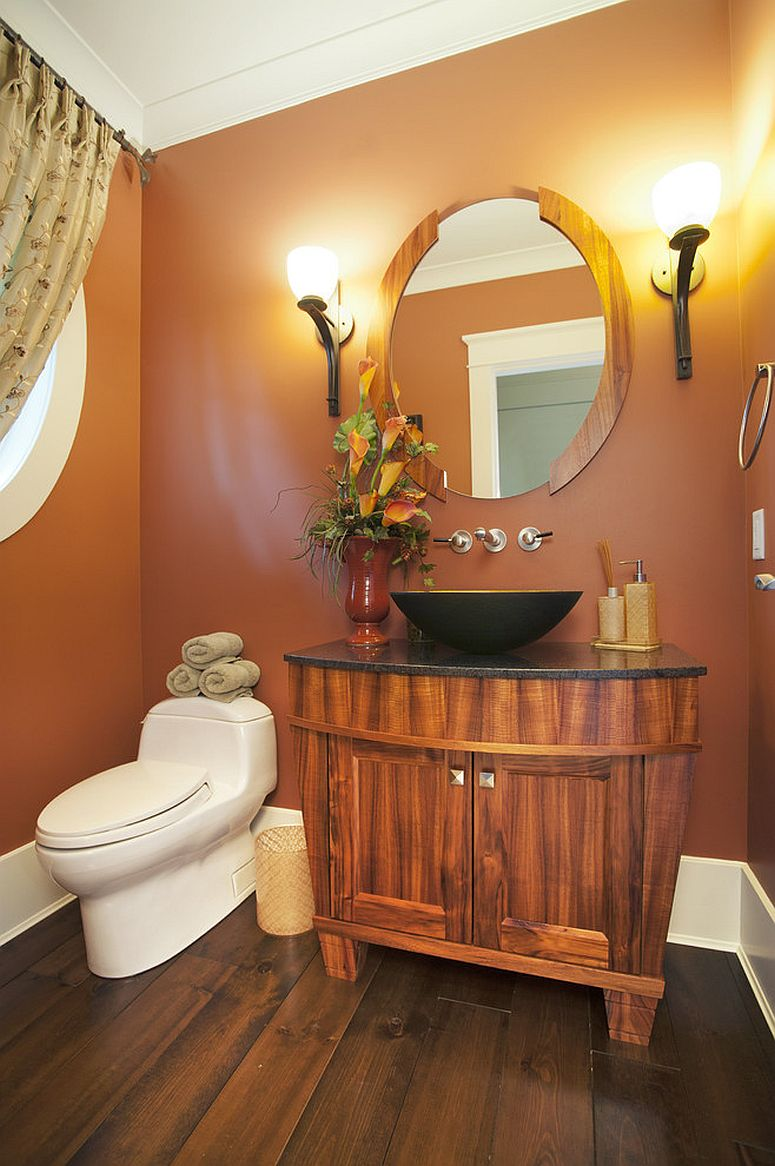 Orange is color of choice inside this magnetic powder room [Design: Old World Kitchens & Custom Cabinets]