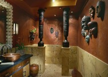 Pacific Island masks and African drums create a fascinatingly unique powder room