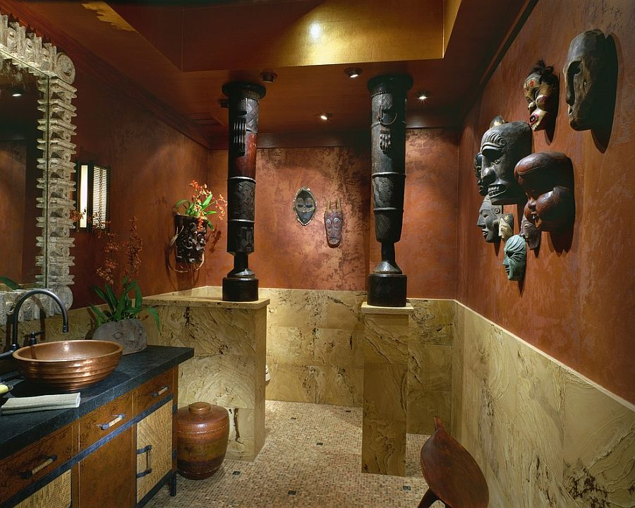 Pacific Island masks and African drums create a fascinatingly unique powder room [Design: Saint Dizier Design]