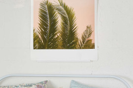 Palm tree art in a bedroom by Urban Outfitters