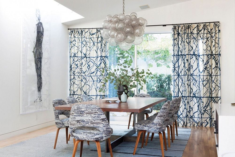Pattern of the drapes adds to the dining table chairs and complements them beautifully
