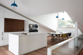 Pop up structure containing the dining area and kitchen brings in ample natural light
