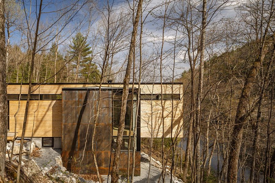 Raw steel structure encases the stairwell and addsto the textural beuaty of the cottage