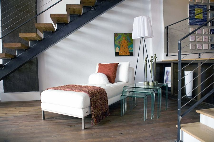Reading and relaxing nook under the staircase with Rosy Angelis Floor Lamp [Design: Sylvia Martin]
