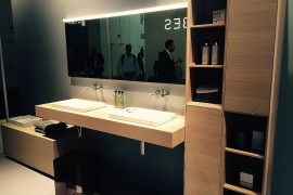 Sleek, floating wooden vanity by Laufen Bathrooms