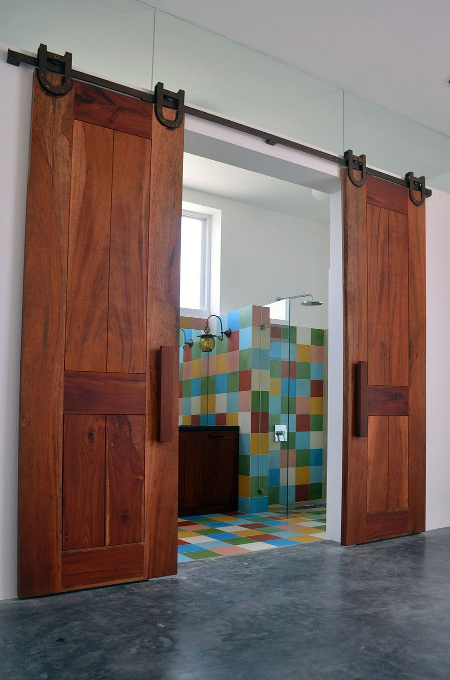 Sliding barn doors for the colorful bathroom