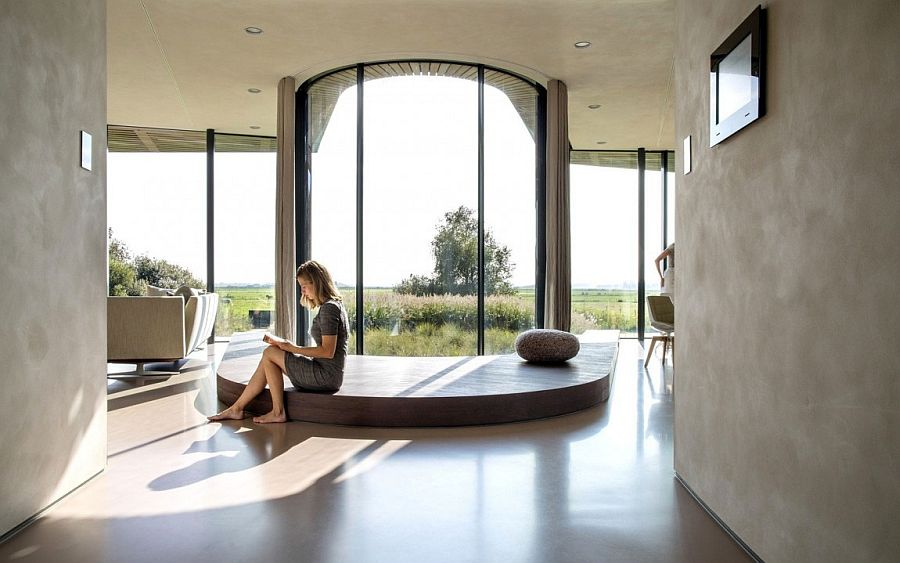 Spacious and light-filled living area with large galss walls
