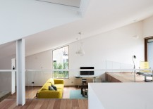 Split-level-dining-area-and-living-space-of-the-Pibo-House-217x155