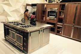 Stunning central kitchen sialnd with multiple fetaures by La Cornue