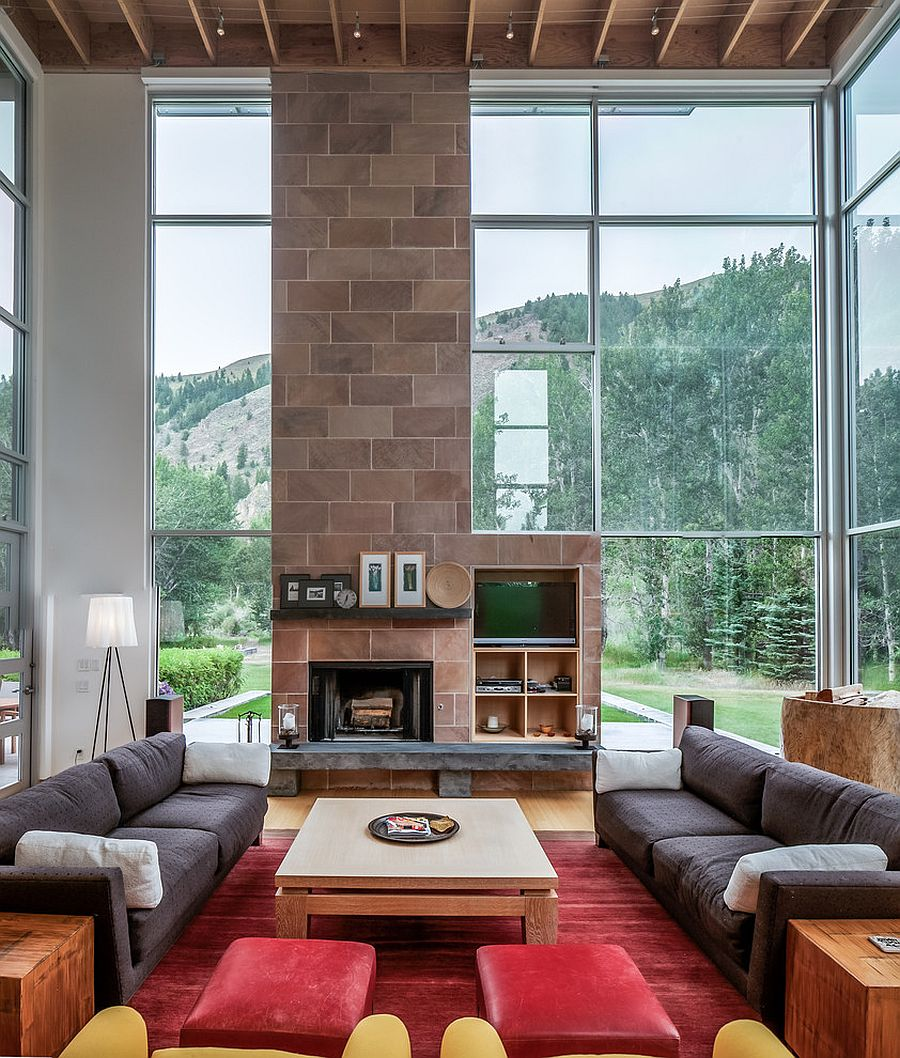 Tall floor lamp is perfect for a living room with high ceiling [Design: Michael Doty Associates Architects]