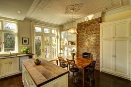 Traditional kitchen and dining area with brick wall and a fabulous ceiling