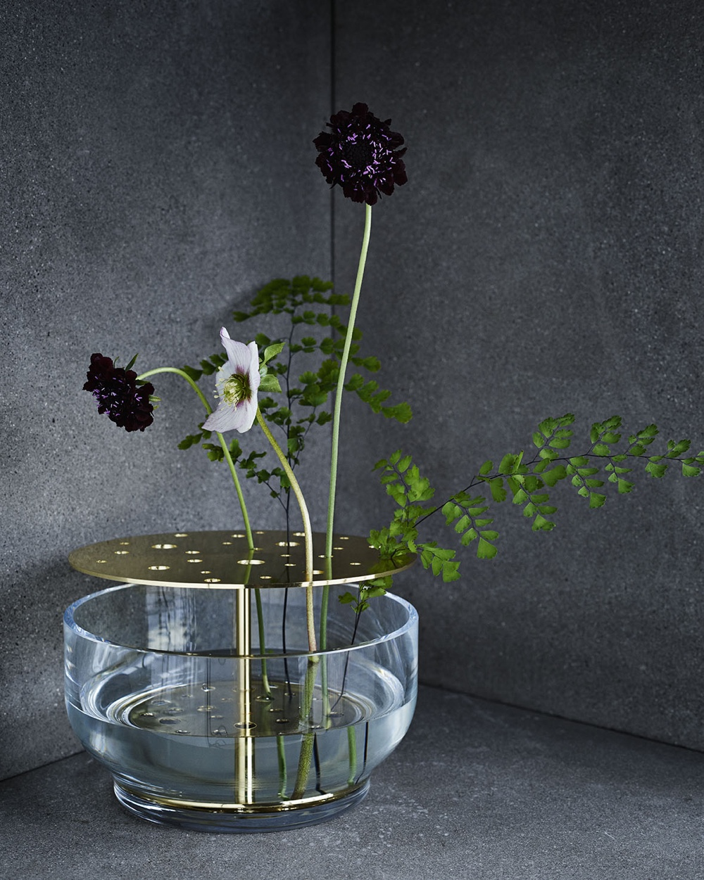 'Ikebana' is the beautiful art form of Japanese flower arranging, where the floral display is governed by strict rules. Reflecting the spirit of Ikebana, Jaime Hayon's blown glass and brass vase will ensure the precise placement of individual stems.