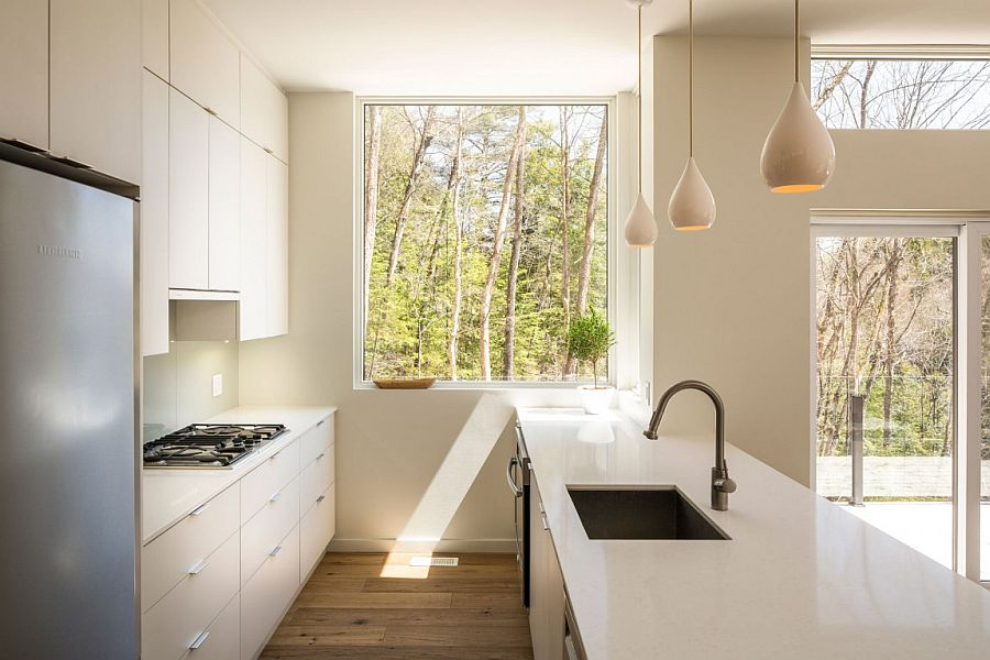 View of the forest landscape from the modern kitchen of the Canadian family cottage