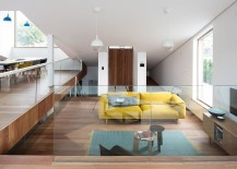 View-of-the-living-area-with-a-bright-yellow-couch-and-ample-natural-light-217x155