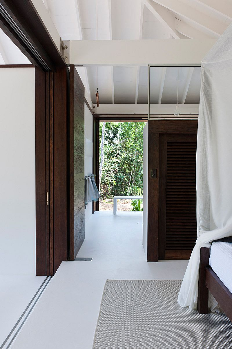 White coupled with dark wooden surfaces inside the beach house