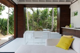 White sectional couch for the living space of the beach house