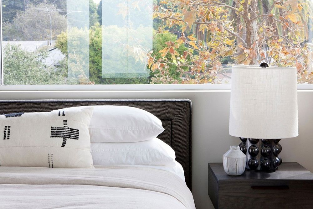 Window above the headboard adds a different look to the modern bedroom