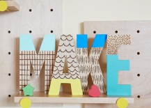 Wood-burned letters from The Land of Nod