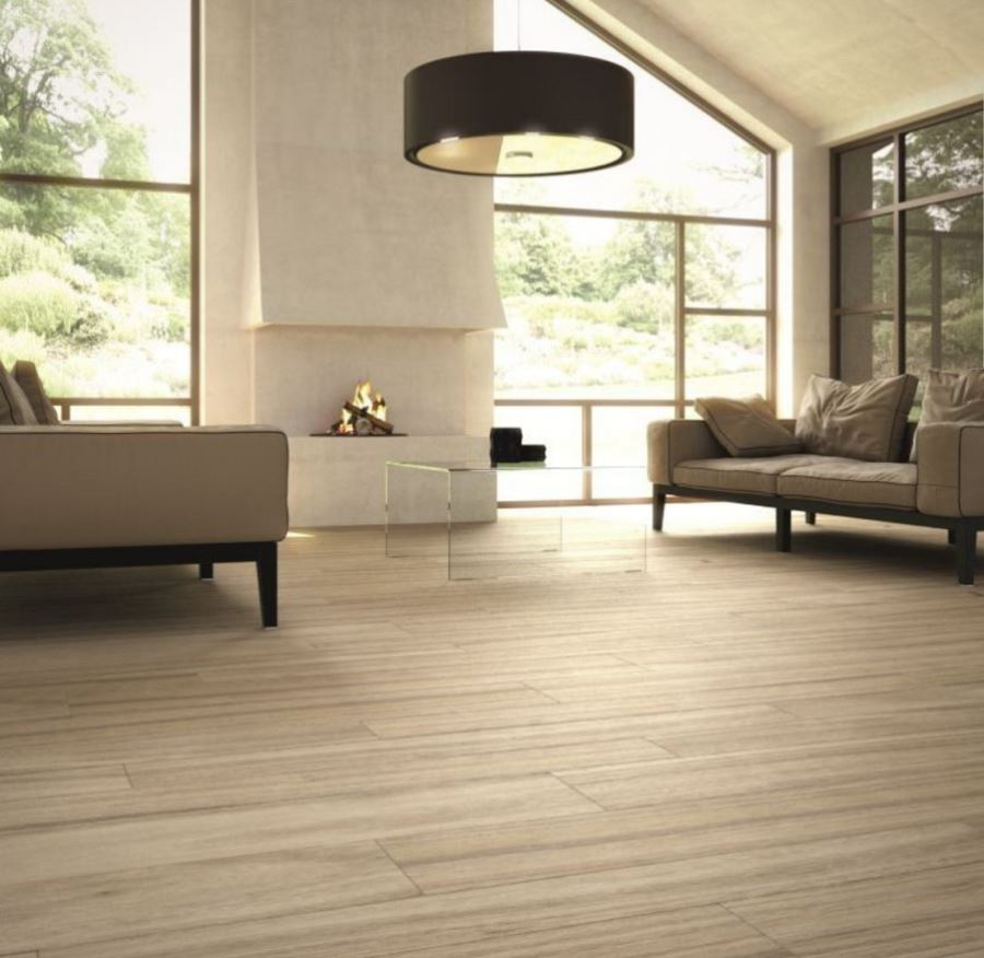 Decorating with porcelain and ceramic tiles that look like for Tiled living room floor designs