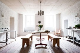 Wooden dining table and benches inside the kitchen