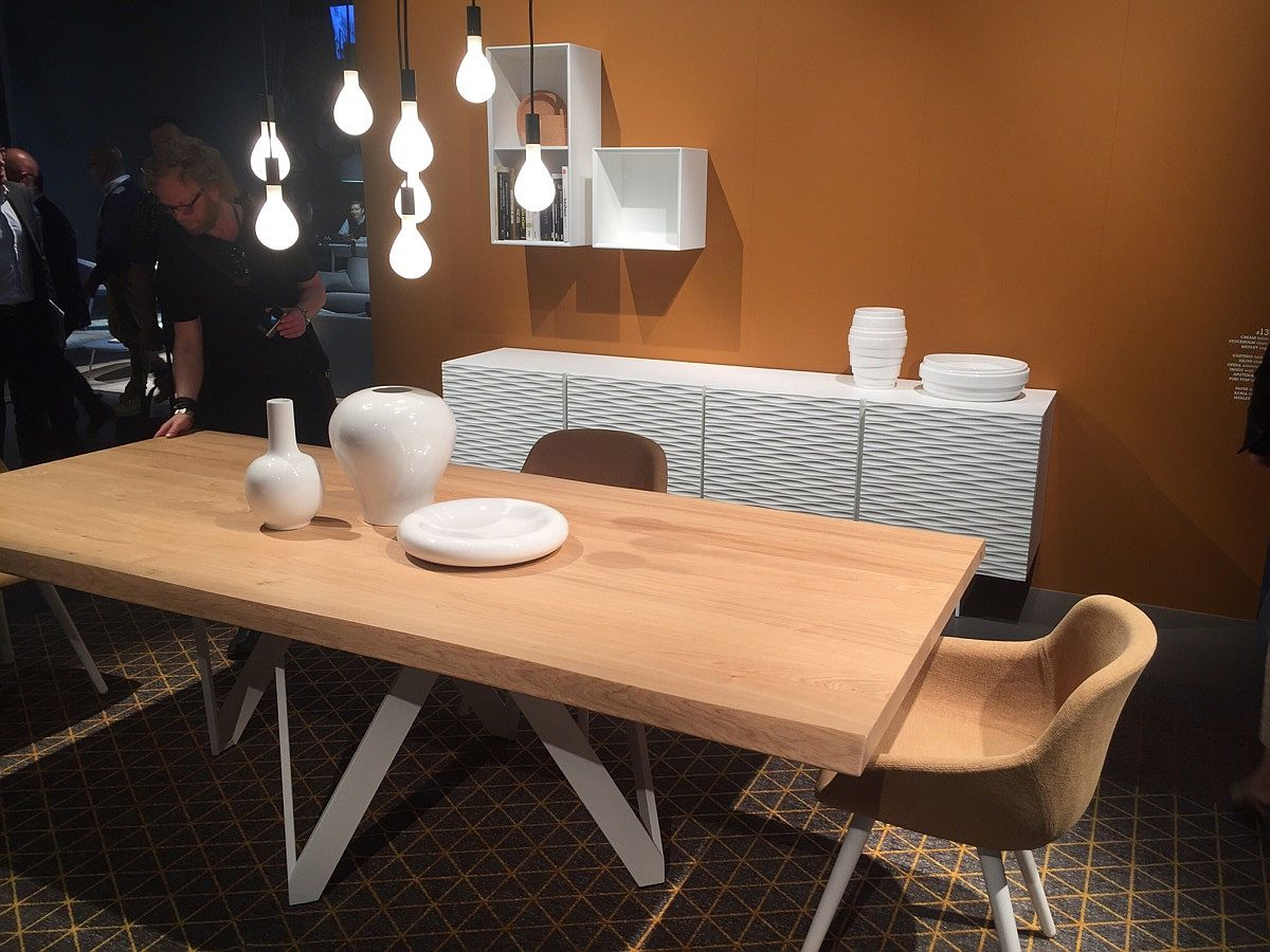 Wooden dining table chairs, lighting and sidetable in the backdrop - Calligaris at Slaone del Mobile 2016