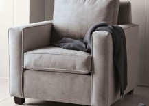 Wooden-paneling-behind-a-comfy-armchair-217x155