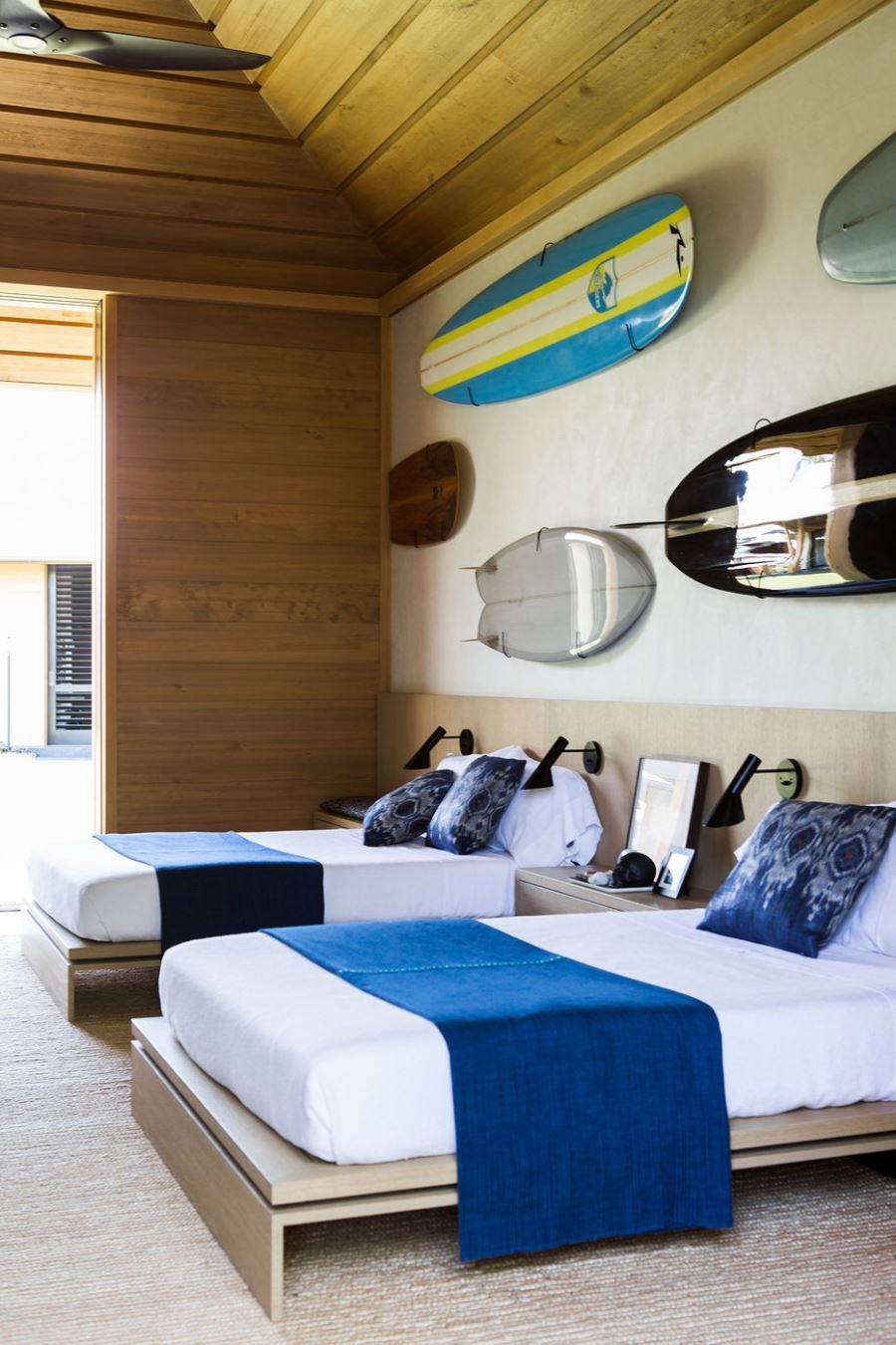 Wooden paneling in a modern beachy bedroom