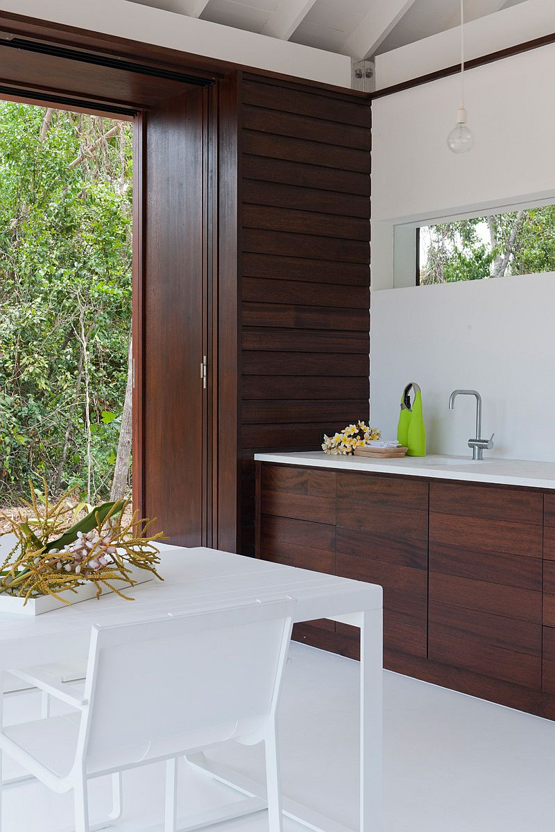 Wooden surfaces inside beach house add warmth to the setting
