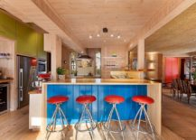 Beautiful beach style kitchen with pops of blue, red and green