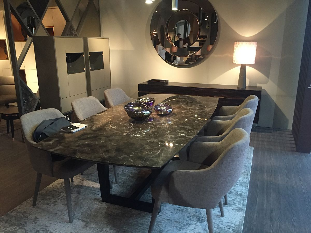 Beautiful dining tables with stone tops are once agian in fashion