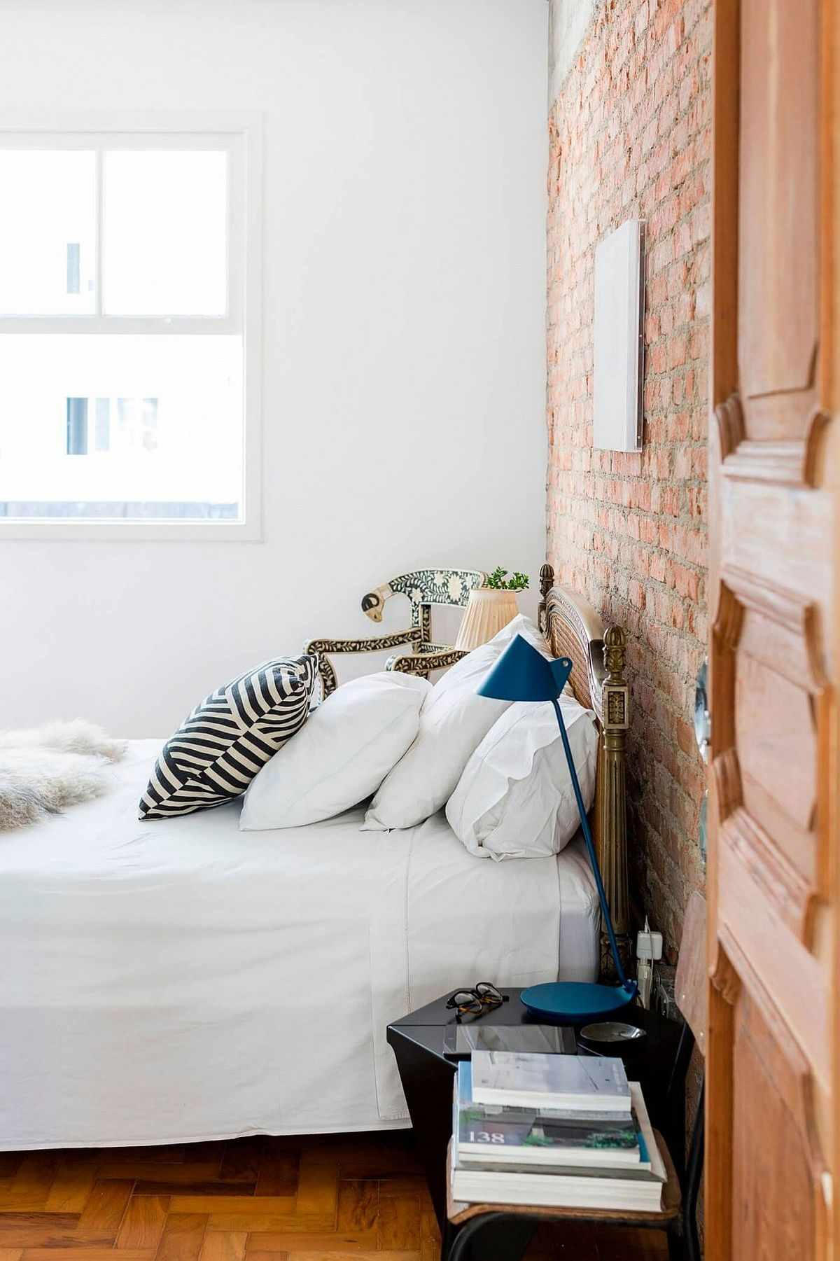 Bedroom inside cheerful Sao Pauloe home with brick accent wall