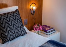 Bedside lighting saves space and adds a hint of industrial style