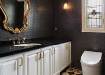 Black and gold are a great combination for a Victorian styled half bath