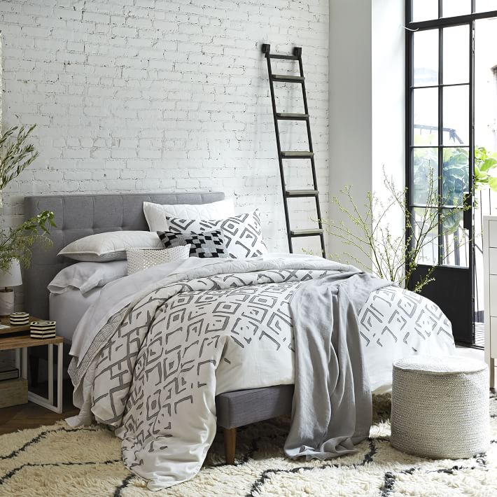 Braided cylinder pouf from West Elm
