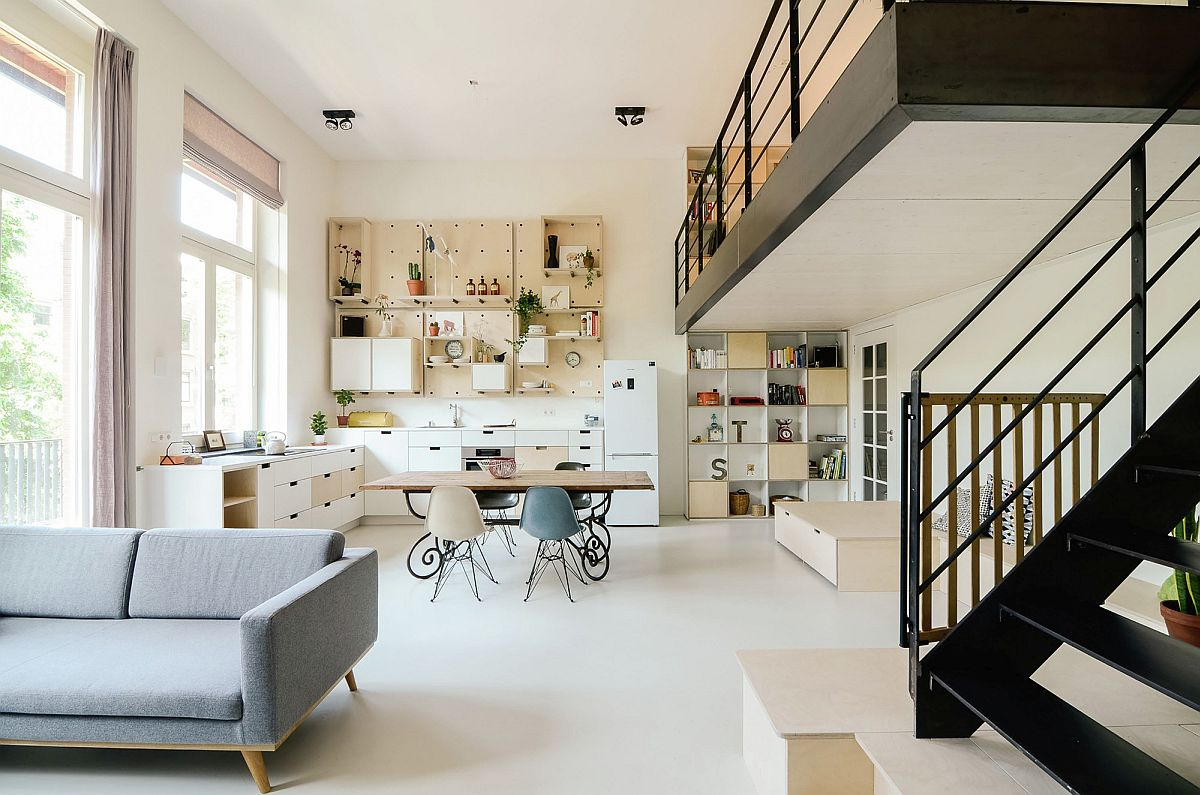 Bright and cheerful living area of the modern apartment in Amsterdam