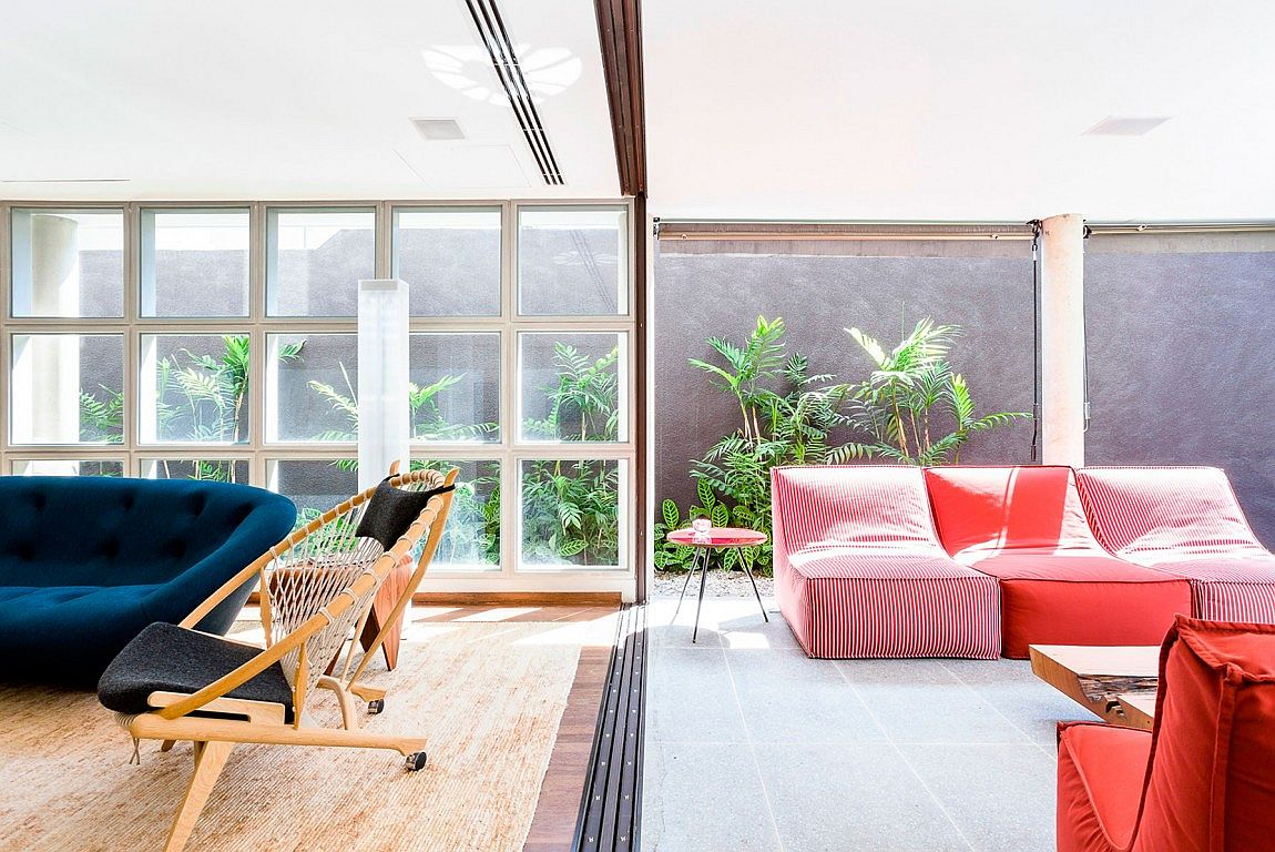 Bright and colorful furniture bring the interior of the Brazilian home alive