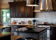 Bright metallic backsplash and hood draw your attention instantly