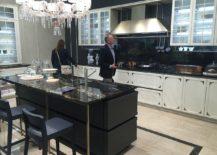 Chic-modern-classic-kitchen-with-dark-kitchen-island-in-stone-217x155