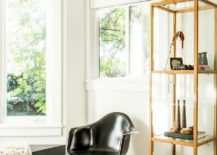 Classic Eames moulded chair and glass bookshelf