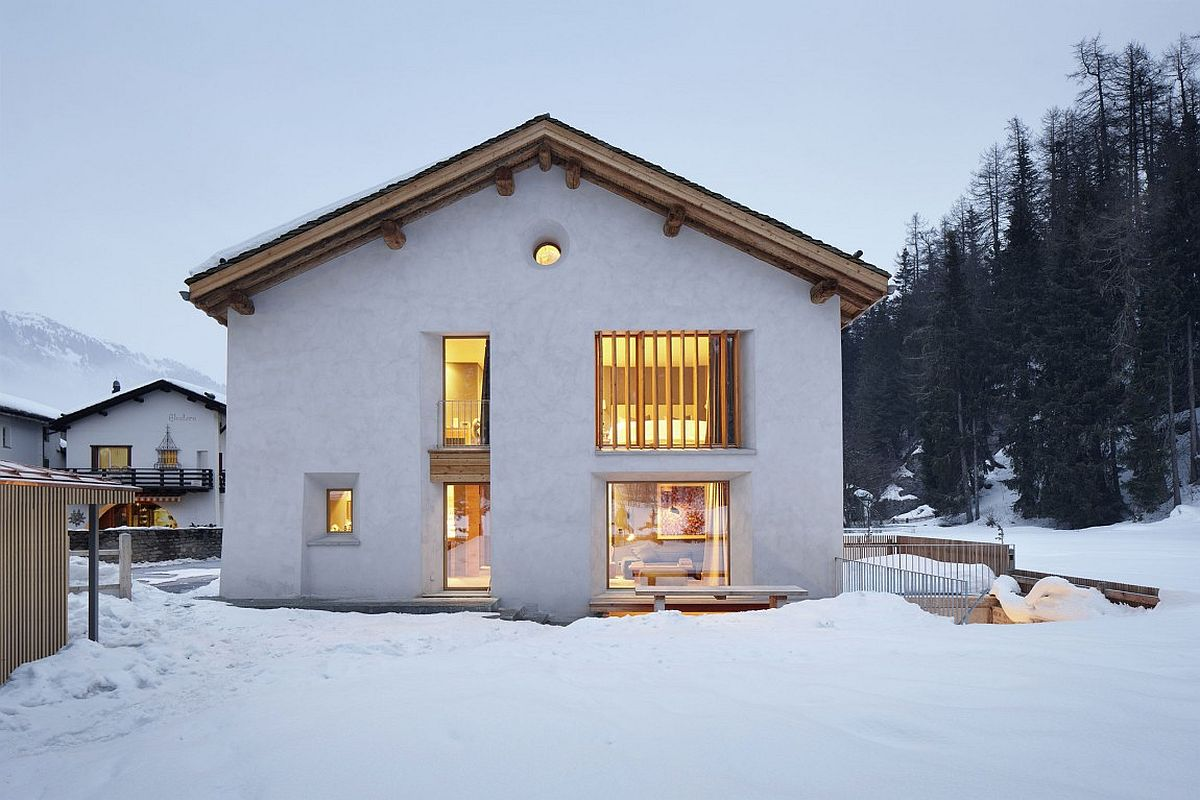 Classic exterior of the old barn house is left intact despite the modern interior In the Majestic Shadow of Alps: Cozy Home Renovation in Sils im Engadin