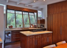 Classic kitchen with sloped window and wooden cabinets