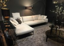 Coffee tables lighting fixtures stand in contrast to the plush couch in light hue