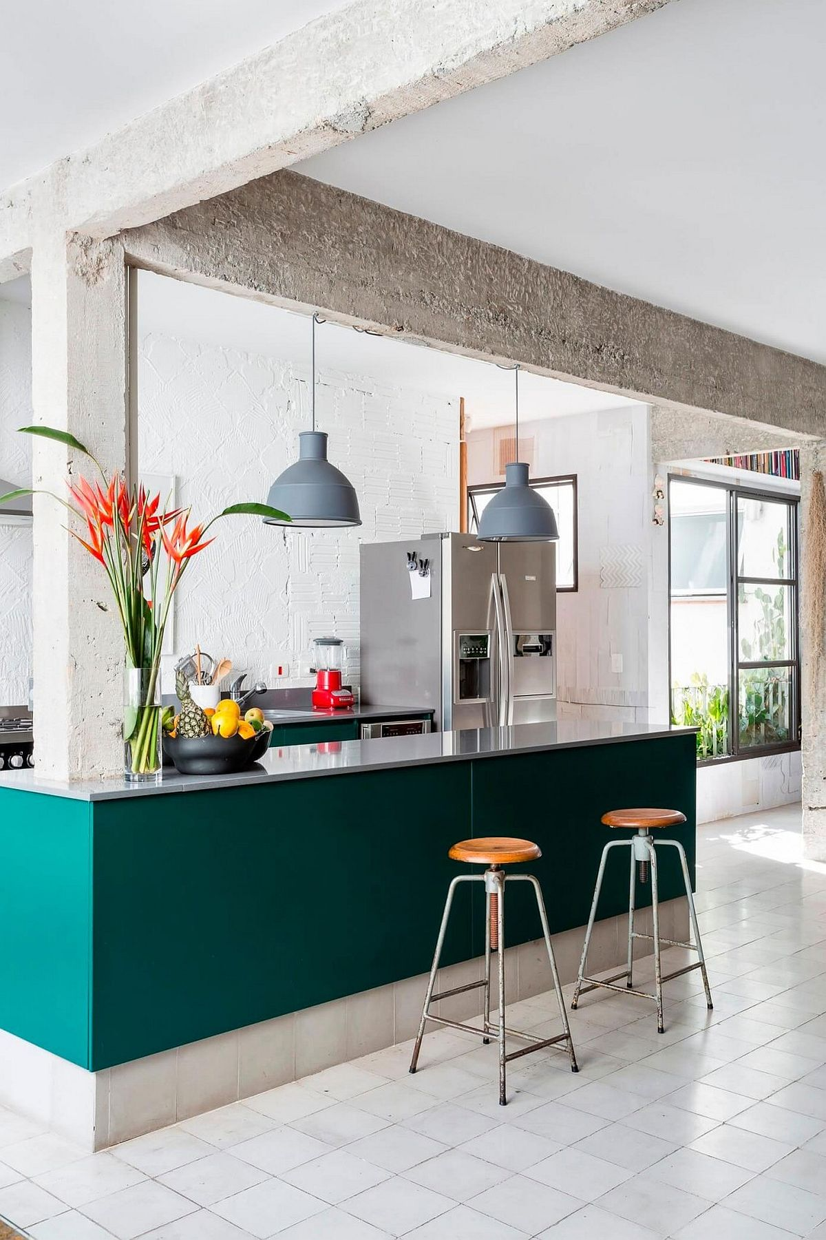 Colorful kitchen island in teal is an absolute showstopper