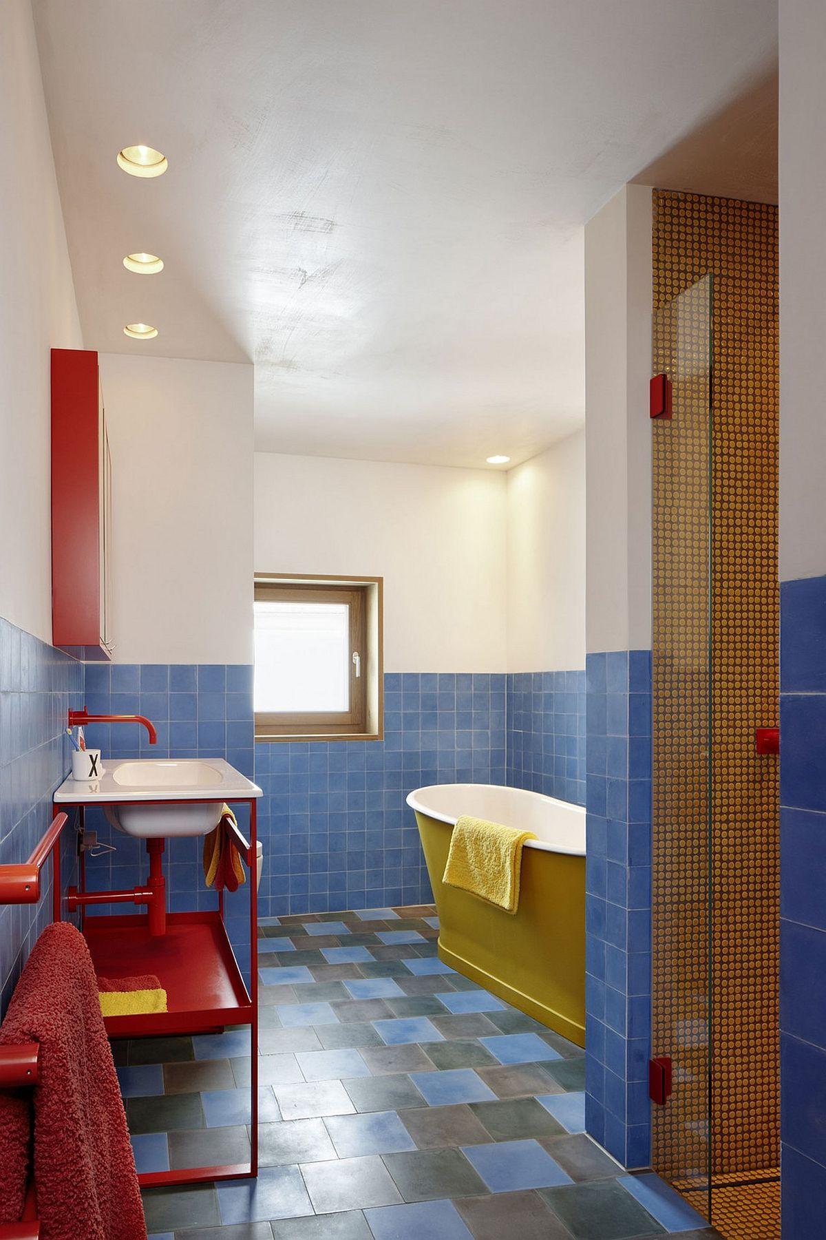 Colorful modern bathroom with standalone bathtub in yellow