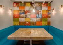 Colorful wall mural and seating for the breakfast zone