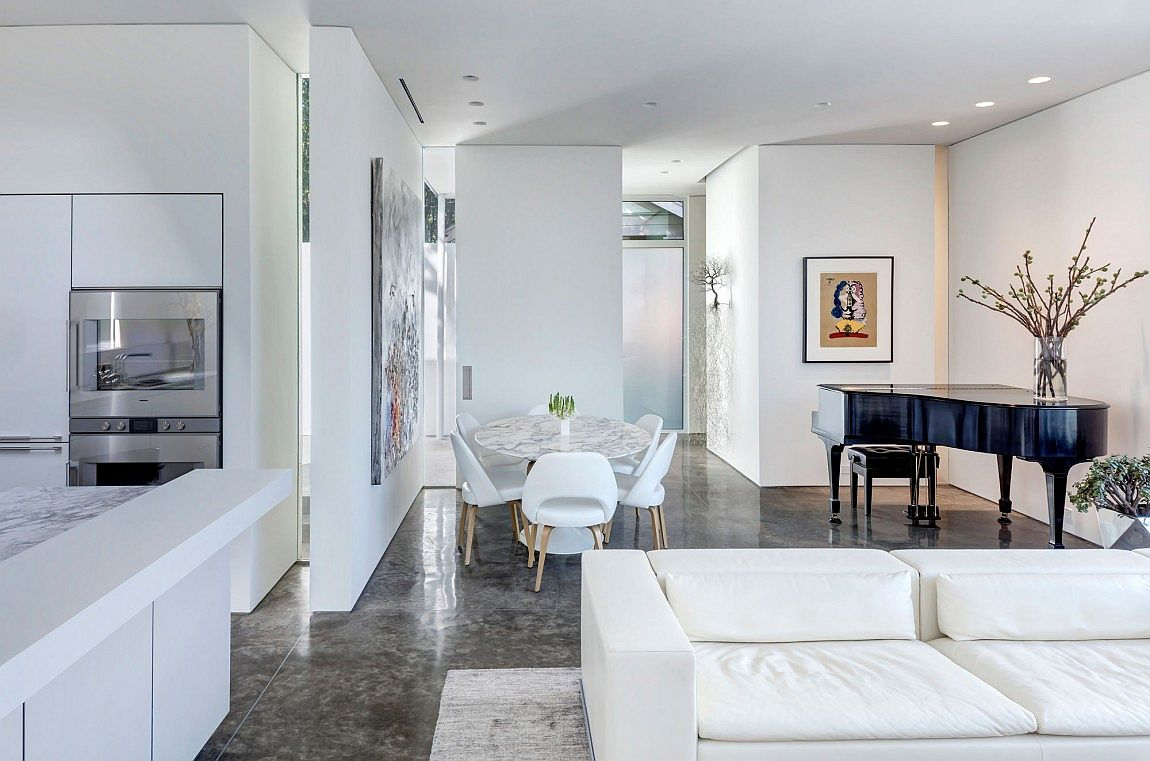 Concrete floor and a splash of marble for the open living area