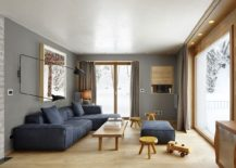 Concrete solid oak and gray walls shape a beautiful living room 217x155 In the Majestic Shadow of Alps: Cozy Home Renovation in Sils im Engadin