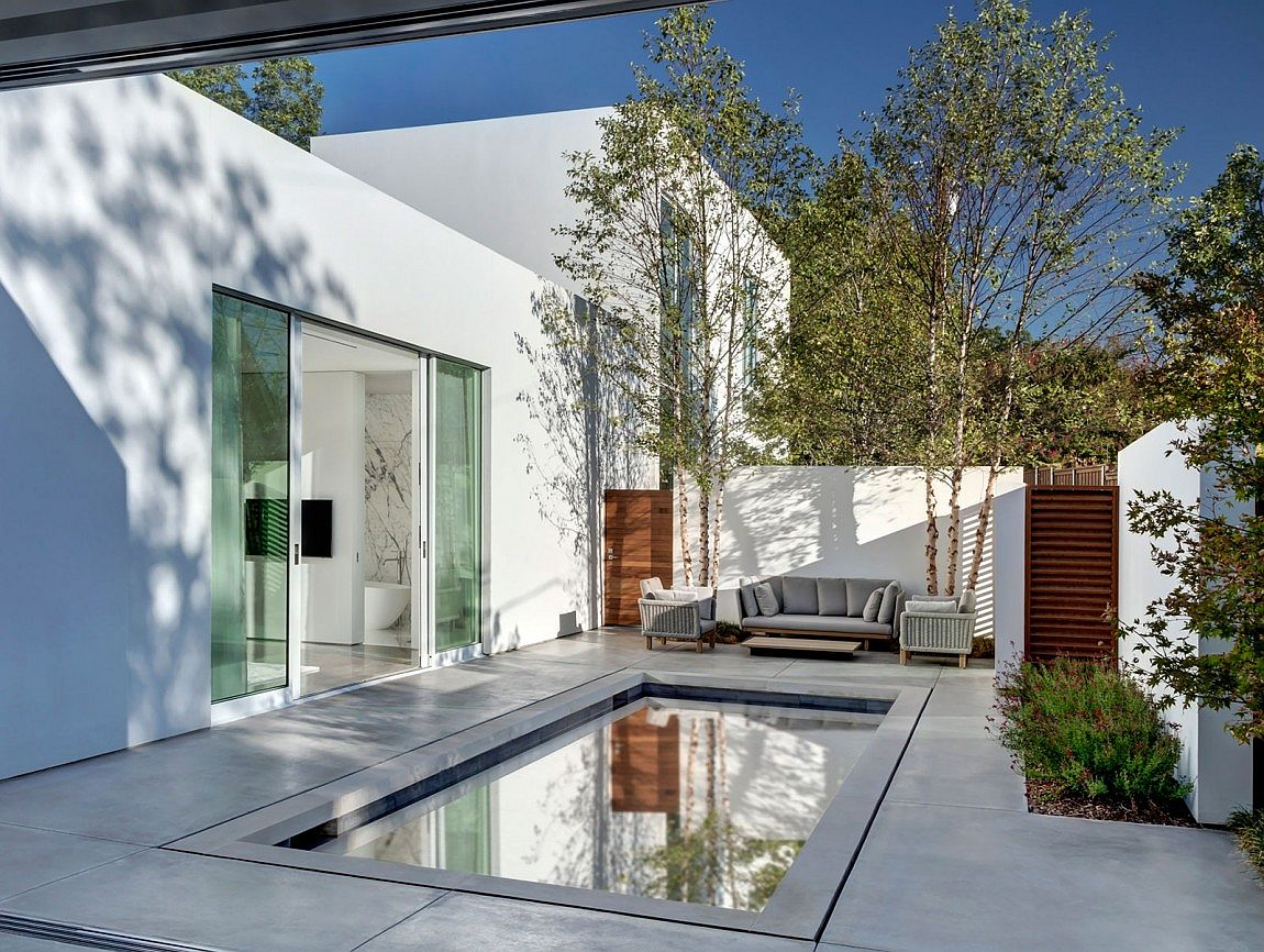 Contemporary and private courtyard design with a small pool